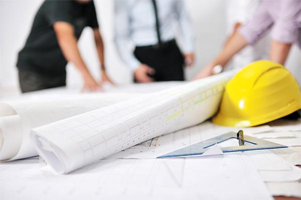 Architects Drafting Blueprints